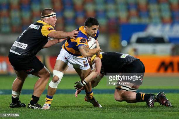Terrence Hepetema of Bay of Plenty is tackled by Brad Tucker and Mitchell Graham of Taranaki during the round five Mitre 10 Cup match between...