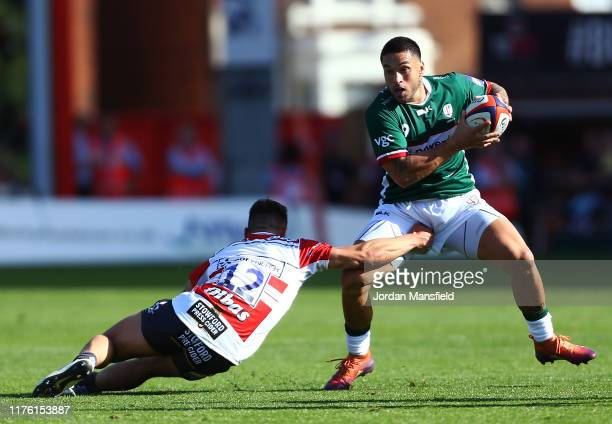 Terrence Hepetema of London Irish avoids a tackle from Tom Seabrook of Gloucester during the Premiership Rugby Cup match between Gloucester Rugby and...