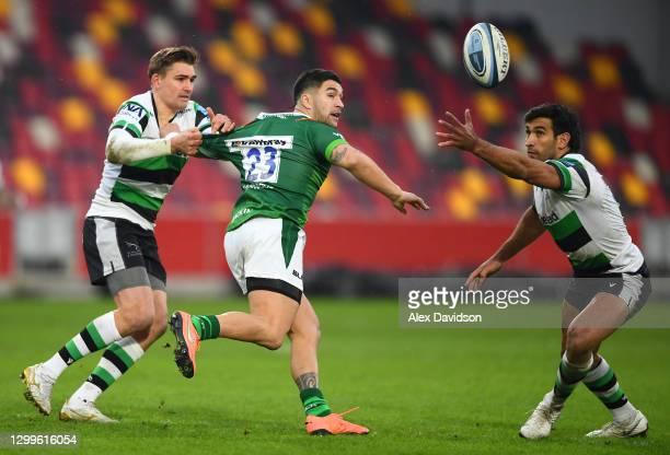 Terrence Hepetema of London Irish offloads under pressure from Toby Flood and Matias Orlando of Newcastle Falcons during the Gallagher Premiership...