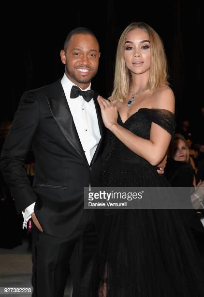 Terrence J and Jasmine Sanders attends Elton John AIDS Foundation 26th Annual Academy Awards Viewing Party at The City of West Hollywood Park on...