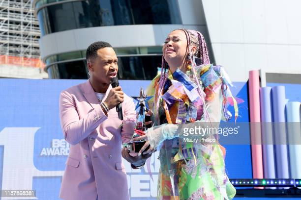 Terrence J and Sho Madjozi winner of Best New International Act award speak onstage during the Pre Show at the 2019 BET Awards at Microsoft Theater...
