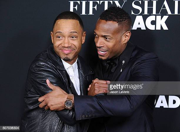Terrence Jenkins and Marlon Wayans attend the premiere of 'Fifty Shades of Black' at Regal Cinemas LA Live on January 26 2016 in Los Angeles...