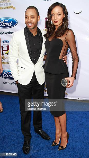Terrence Jenkins and model Selita Ebanks walk the blue carpet at the 10th Annual Ford Hoodie Awards at MGM Garden Arena on August 4, 2012 in Las...