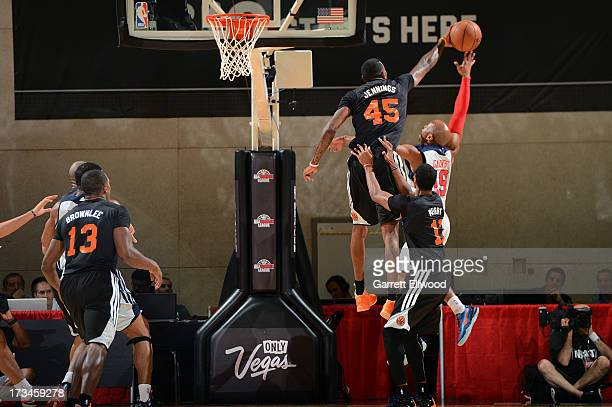 Terrence Jennings of the New York Knicks blocks a shot against Sundiata Gaines of the Washington Wizards during NBA Summer League on July 14 2013 at...