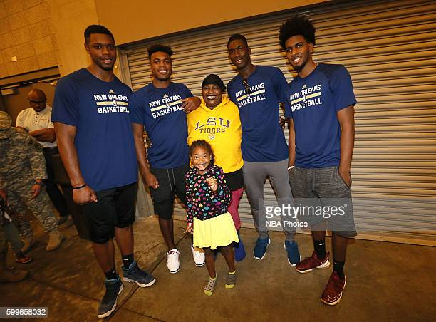 Terrence Jones Buddy Hield Shawn Dawson and Cheick Diallo of the New Orleans Pelicans participate in a community outreach initiative which had...