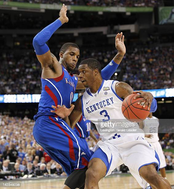 Terrence Jones of Kentucky drives against Thomas Robinson of Kansas in the NCAA Tournament finals at the MercedesBenz Superdome on Monday April 2 in...