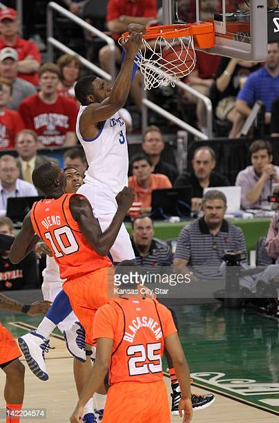 Terrence Jones of Kentucky soars in for a dunk against Louisville in the first half of the NCAA Tournament semifinals at the MercedesBenz Superdome...