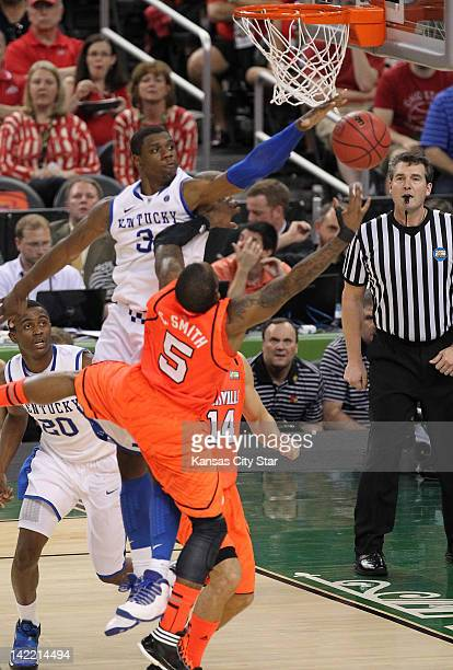 Terrence Jones of Kentucky tries to block Chris Smith of Louisville in the NCAA Tournament semifinals at the MercedesBenz Superdome in New Orleans...