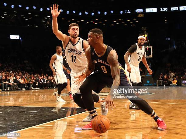Terrence Jones of New Orleans Pelicans and Joe Harris of Brooklyn Nets during an NBA match against Brooklyn nets at Barclays Center in Brooklyn...