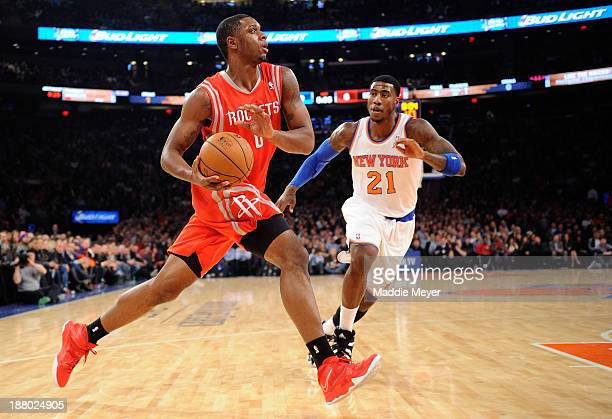 Terrence Jones of the Houston Rockets drives past Iman Shumpert of the New York Knicks during the first quarter at Madison Square Garden on November...