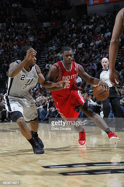 Terrence Jones of the Houston Rockets drives to the basket against Kawhi Leonard of the San Antonio Spurs on November 30 2013 at the ATT Center in...