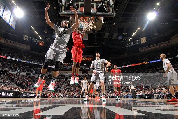 Terrence Jones of the Houston Rockets dunks the ball against the San Antonio Spurs during the game at the ATT Center on December 25 2013 in San...