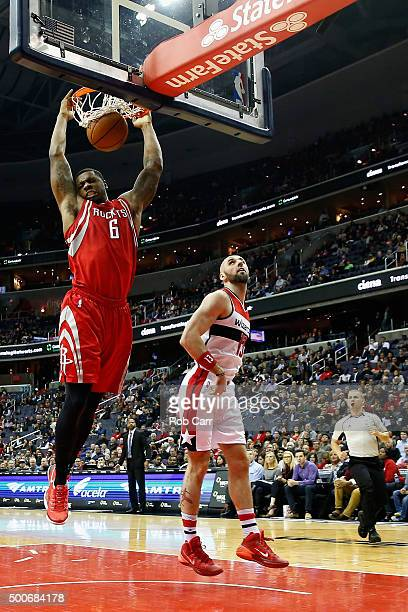 Terrence Jones of the Houston Rockets dunks the ball in front of Marcin Gortat of the Washington Wizards in the first half at Verizon Center on...