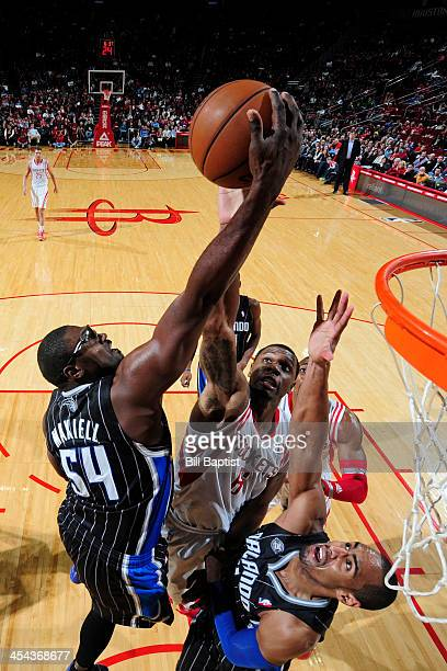 Terrence Jones of the Houston Rockets shoots against Jason Maxiell of the Orlando Magic on December 8 2013 at the Toyota Center in Houston Texas NOTE...