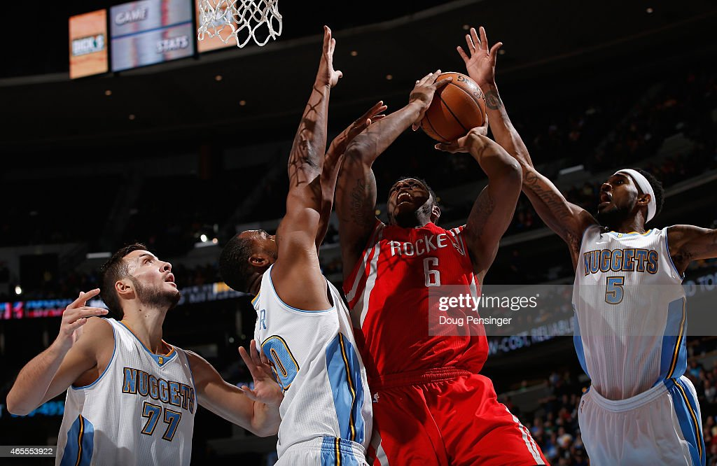 Terrence Jones #6 of the Houston Rockets tries to get off a shot against Darrell Arthur #00 and Joffrey Lauvergne #77 of the Denver Nuggets as Will Barton #5 of the Denver Nuggets comes from behind to block the shot at Pepsi Center on March 7, 2015 in Denver, Colorado.