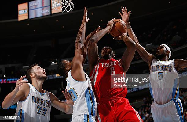 Terrence Jones of the Houston Rockets tries to get off a shot against Darrell Arthur and Joffrey Lauvergne of the Denver Nuggets as Will Barton of...