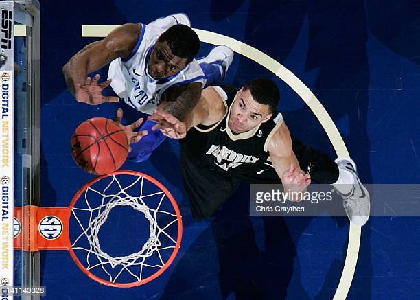 Terrence Jones of the Kentucky Wildcats and Jeffery Taylor of the Vanderbilt Commodores vie for a rebound during the championship game of the 2012...