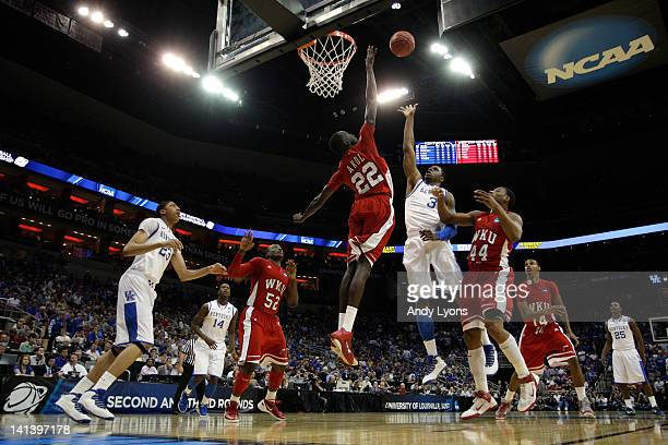 Terrence Jones of the Kentucky Wildcats attempts a shot against Teeng Akol and George Fant of the Western Kentucky Hilltoppers in the first half...
