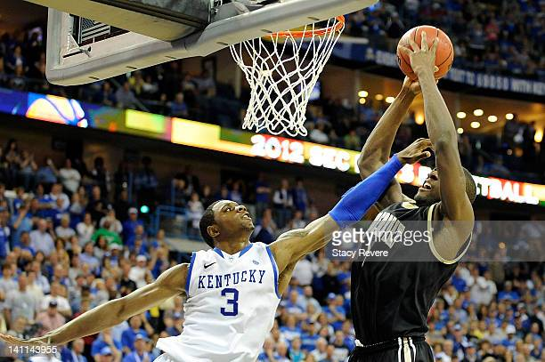 Terrence Jones of the Kentucky Wildcats defends a shot by Festus Ezeli of the Vanderbilt Commodores during the championship game of the SEC Men's...
