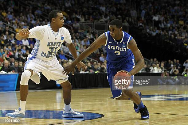 Terrence Jones of the Kentucky Wildcats dribbles the ball against John Henson of the North Carolina Tar Heels during the first half ofthe east...
