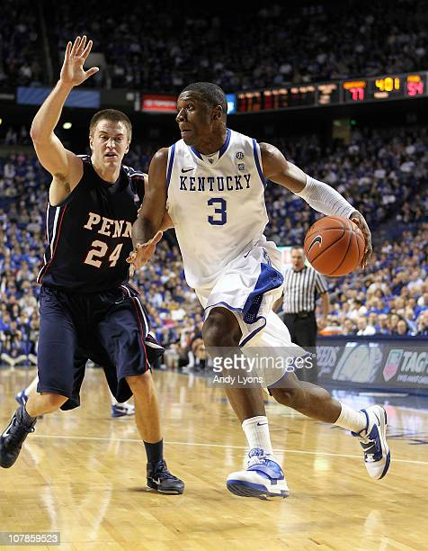 Terrence Jones of the Kentucky Wildcats dribbles the ball while defended by Jack Eggleston of the Penn Quakers at Rupp Arena on January 3 2011 in...