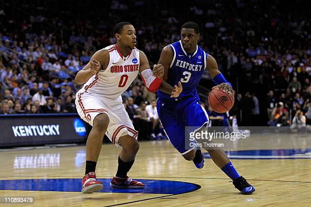 Terrence Jones of the Kentucky Wildcats drives against Jared Sullinger of the Ohio State Buckeyes during the first half of the east regional...