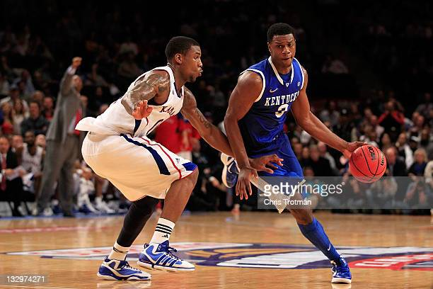 Terrence Jones of the Kentucky Wildcats drives the ball against Thomas Robinson of the Kansas Jayhawks during the 2011 State Farms Champions Classic...