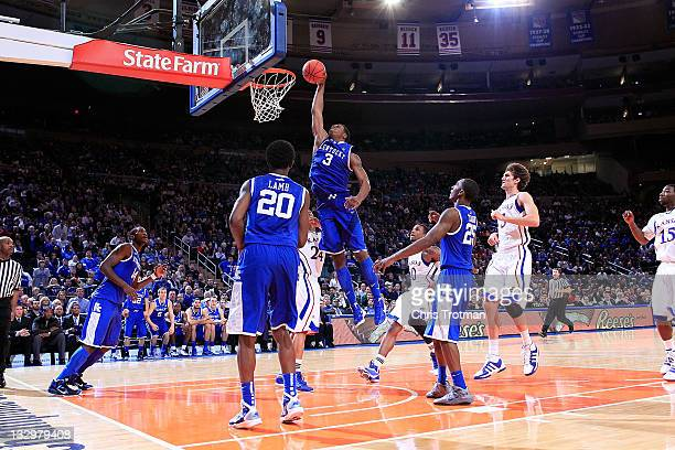 Terrence Jones of the Kentucky Wildcats dunks the ball against the Kansas Jayhawks during the 2011 State Farms Champions Classic at Madison Square...
