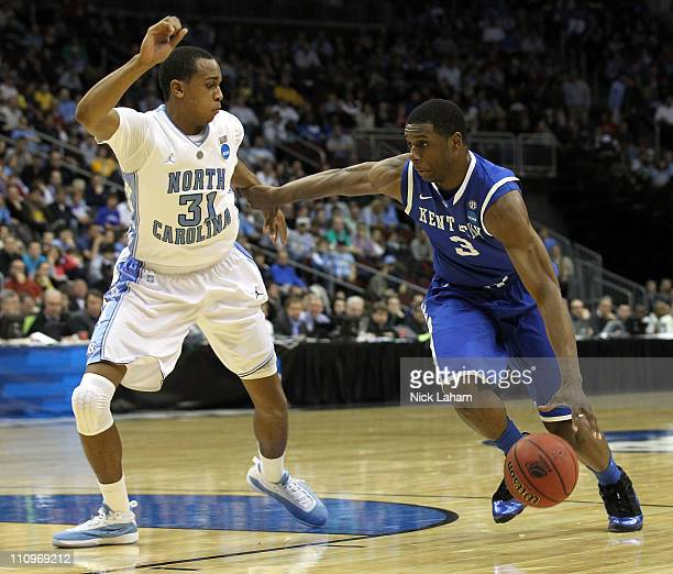 Terrence Jones of the Kentucky Wildcats in action against John Henson of the North Carolina Tar Heels during the east regional final of the 2011 NCAA...