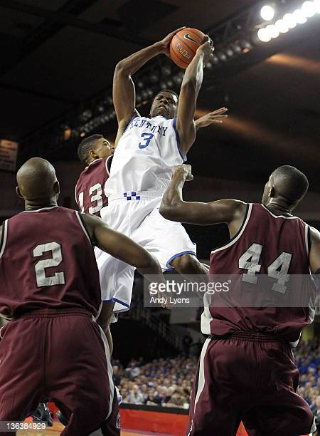 Terrence Jones of the Kentucky Wildcats reaches for a rebound during the game against the ArkansasLittle Rock Trojans at Freedom Hall on January 3...
