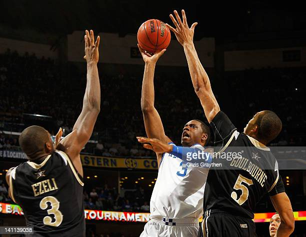 Terrence Jones of the Kentucky Wildcats shoots between Festus Ezeli and Lance Goulbourne of the Vanderbilt Commodores in the first half during the...