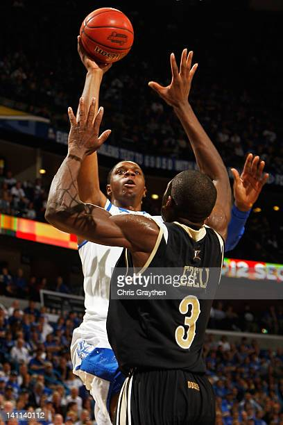 Terrence Jones of the Kentucky Wildcats shoots over Festus Ezeli of the Vanderbilt Commodores in the first half during the championship game of the...