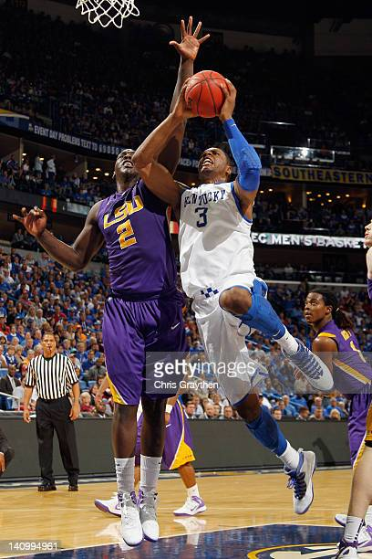 Terrence Jones of the Kentucky Wildcats shoots the ball over Johnny O'Bryant III of the LSU Tigers during the quarterfinals of the SEC Men's...