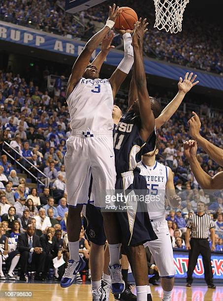 Terrence Jones of the Kentucky Wildcats shoots the ball while defended by Isiah Brown of the East Tennessee State Buccaneers during the game at Rupp...