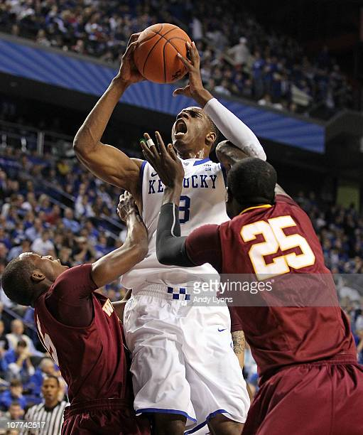 Terrence Jones of the Kentucky Wildcats shoots the ball while defended by Joab Jerome and Julius Francis of the Winthrop Eagles during the game on...