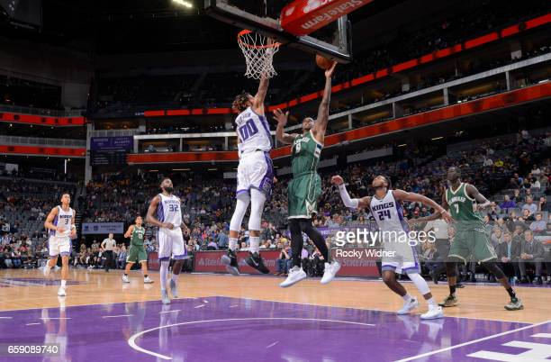 Terrence Jones of the Milwaukee Bucks shoots a layup against Willie CauleyStein of the Sacramento Kings on March 22 2017 at Golden 1 Center in...