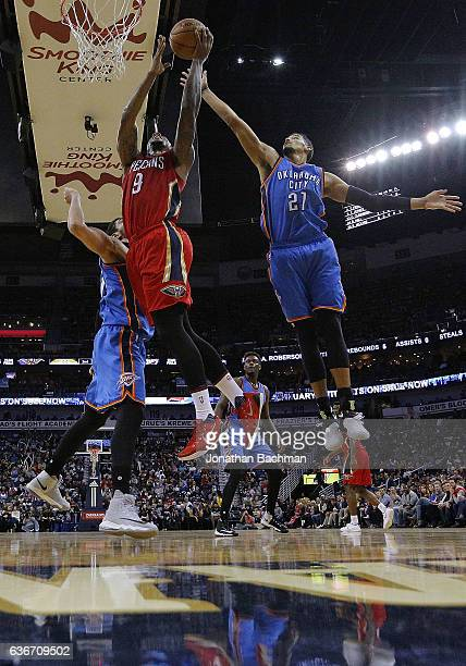 Terrence Jones of the New Orleans Pelicans drives to the basket against Andre Roberson of the Oklahoma City Thunder during the first half of a game...