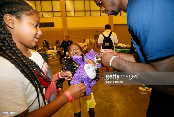 Terrence Jones of the New Orleans Pelicans participates in a community outreach initiative which had players spend time with residents that have been...