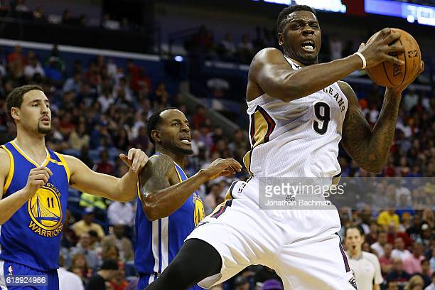 Terrence Jones of the New Orleans Pelicans pulls in a rebound over Klay Thompson of the Golden State Warriors and Andre Iguodala during the first...