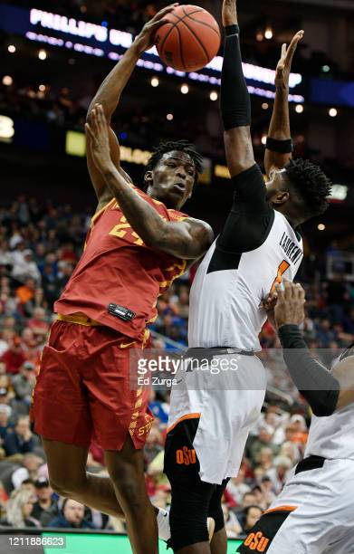 Terrence Lewis of the Iowa State Cyclones passes against Jonathan Laurent of the Oklahoma State Cowboys in the second half during the first round of...