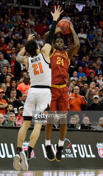 Terrence Lewis of the Iowa State Cyclones shoots against Lindy Waters III of the Oklahoma State Cowboys in the first half during the first round of...