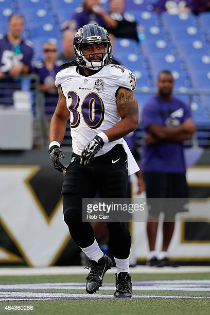 Terrence Magee of the Baltimore Ravens warms up against the New Orleans Saints during a preseason game at MT Bank Stadium on August 13 2015 in...