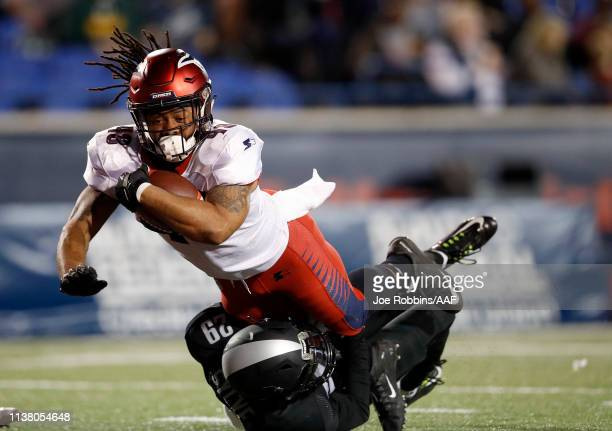 Terrence Magee of the Memphis Express is tackled by Bradley Sylve of the Birmingham Iron during the first half of their Alliance of American Football...
