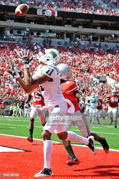 Terrence McCrae the Ohio Bobcats catches a touchdown pass in the fourth quarter as Corey Brown of the Ohio State Buckeyes defends at Ohio Stadium on...