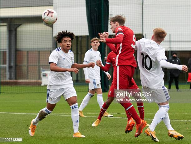 Terrence McLaughlin Miles of Liverpool and Alfie Hughes of Leeds United in action at Melwood Training Ground on November 21, 2020 in Liverpool,...