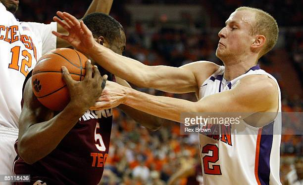 Terrence Oglesby of the Clemson Tigers battles Dorenzo Hudson of the Virginia Tech Hokies for this rebound at Littlejohn Coliseum on February 25,...