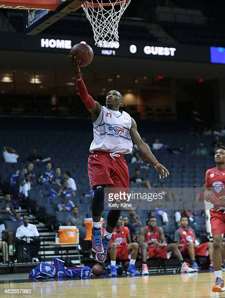 Terrence Philips in white with the layup during the National Basketball Players Association Top 100 Camp on June 18 2014 at John Paul Jones Arena in...