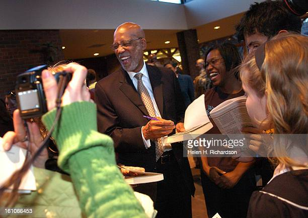 Terrence Roberts signs autographs for eager fans after the interfaith service at Congregation Emanuel <cq> The nine members of what is now called the...