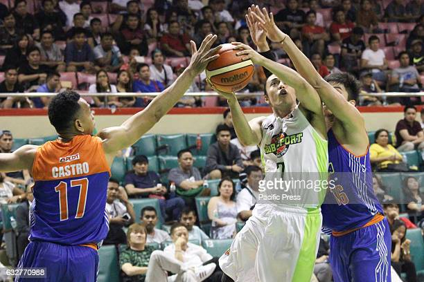 Terrence Romeo of Globalport tries to convert a layup over the defense of both Jason Castro and Roger Pogoy of TNT Katropa TNT Katropa escapes...