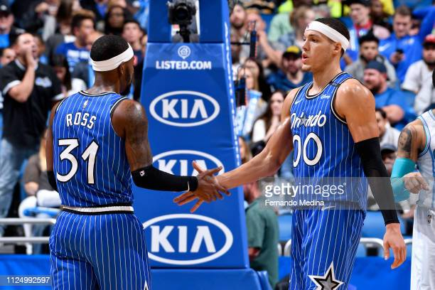 Terrence Ross and Aaron Gordon of the Orlando Magic high five during the game against the Charlotte Hornets on February 14 2019 at Amway Center in...